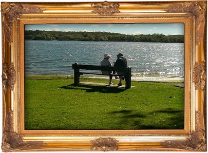Photo: Couple sitting by beach